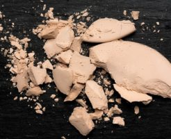 Crushed Compact Powder Mineral on Blackboard