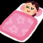 布団で寝ている女性のイラスト